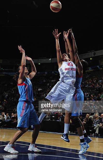 Lauren ThomasJonhson of Great Britain jumps for the ball with Erika de Souza of Atlanta Dream during the WNBA Live basketball match between Atlanta...