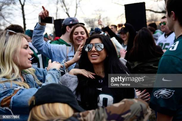 Lauren Vainer of Newtown Square Pennsylvania dances with friends Angelica Van Houten of Doylestown Pennsylvania and Katie Cook of West Chester...