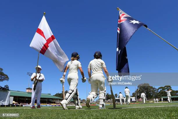Lauren Winfield and Tammy Beaumont of England take to the field during day four of the Women's Test match between Australia and England at North...