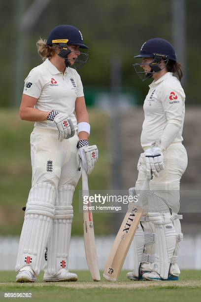 Lauren Winfield of England and Tamsin Beaumont of England speak between overs during day one of the Women's Tour match between England and the...