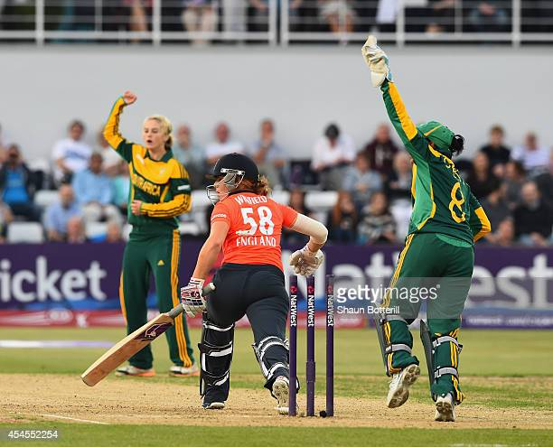Lauren Winfield of England is stumped by South Africa wicketkeeper Trisha Ghetty off the bowling of Dane van Niekerk during the NatWest Women's...