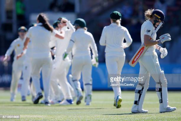 /Lauren Winfield of England looks dejected after being dismissed by Tahlia McGrath of Australia during the Women's Test match between Australia and...