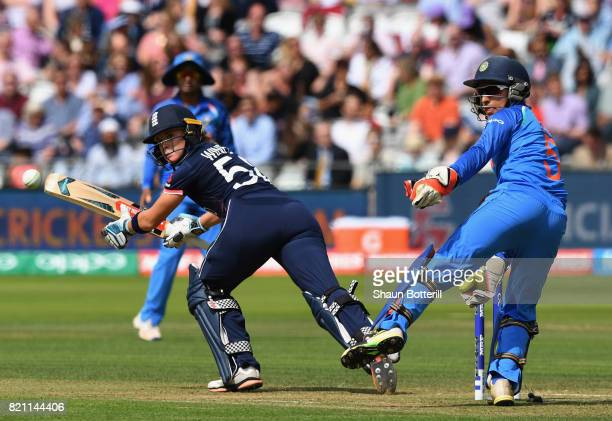 Lauren Winfield of England plays a shot as wicket keeper Sushma Verma of India looks onduring the ICC Women's World Cup 2017 Final between England...