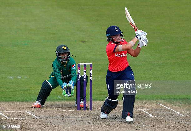 Lauren Winfield of England scores runs as Sidra Nawaz of Pakistan looks on during the 1st Natwest International T20 played between England Women and...