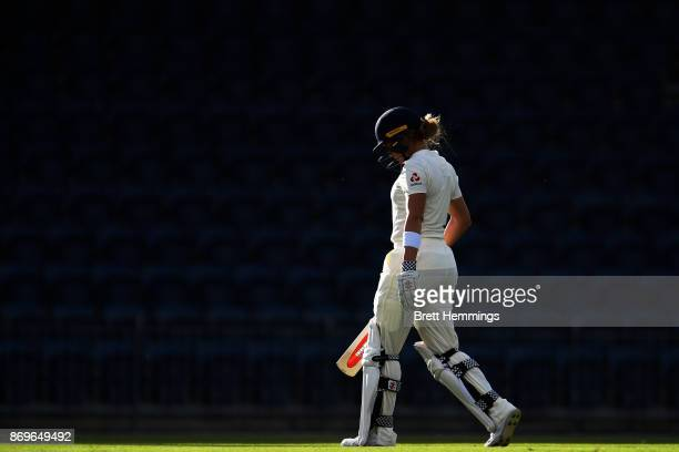 Lauren Winfield of England walks from the field after being dismissed by Sophie Molineux of CAXI during day one of the Women's Tour match between...
