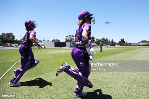 Lauren Winfirled and Georgia Redmayne of the Hobart Hurricanes open the batting during the Women's Big Bash League WBBL match between the Strikers...