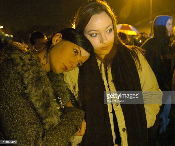 Lauren Wyatt and her sister Tarisa take part in an impromptu vigil outside of the Alrosa Villa Club on December 9, 2004 in Columbus, Ohio. According...