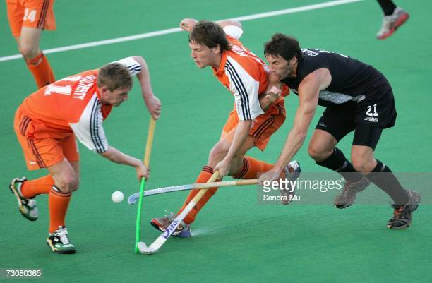 Laurence Docherty and Eby Kessing of the Netherlands in action with Bryce Collins of New Zealand during the match between the Black Sticks Men and...