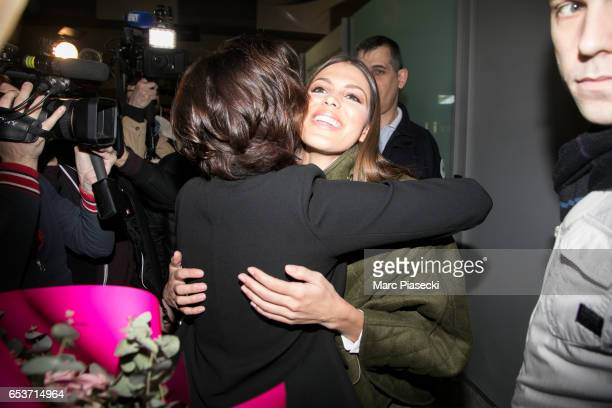 Laurence Druart welcomes her daughter Miss Universe Iris Mittenaere as she arrives at Aeroport Roissy Charles de Gaulle on March 16 2017 in Paris...