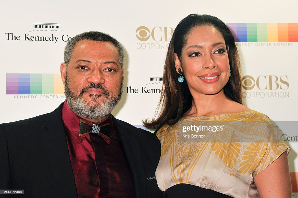Laurence Fishburne and Gina Torres arrive at the 38th Annual Kennedy Center Honors Gala at the Kennedy Center for the Performing Arts on December 6, 2015 in Washington, DC.