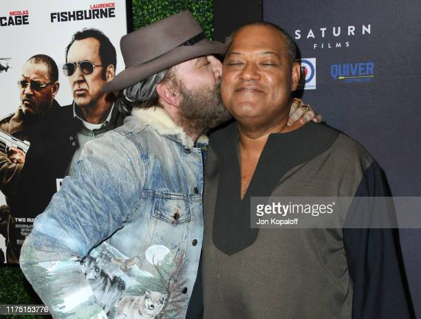 """Laurence Fishburne and Nicolas Cage attend the Premiere Of Quiver Distribution's """"Running With The Devil"""" at Writers Guild Theater on September 16,..."""