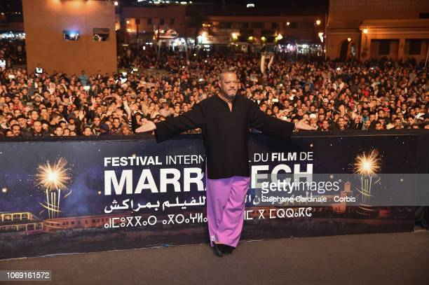 Laurence Fishburne attends the screening of 'AntMan and The Wasp' at Jemaa El Fna Place during 17th Marrakech International Film Festival on December...