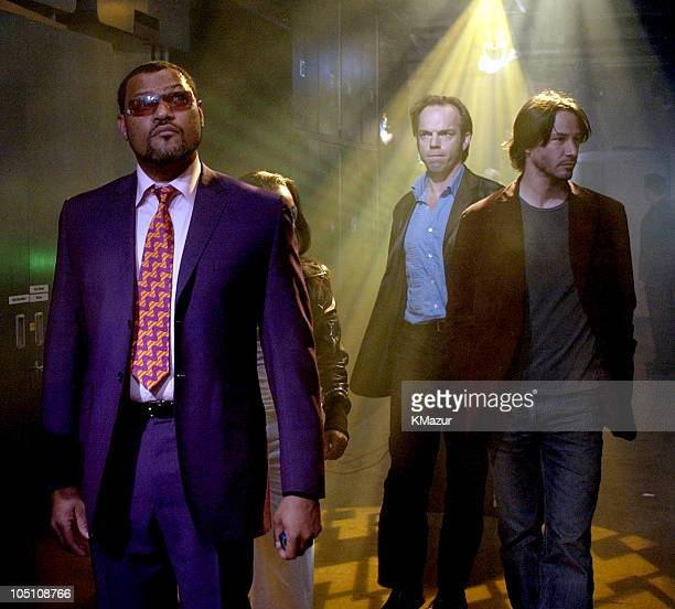 Laurence Fishburne Hugo Weaving and Keanu Reeves during The Cast of The Matrix Reloaded and POD Visit MTV's TRL May 5 2003 at MTV Studios Times...