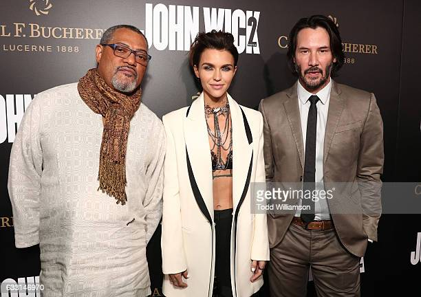 Laurence Fishburne Ruby Rose and Keanu Reeves attends the Premiere Of Summit Entertainment's John Wick Chapter Two at ArcLight Hollywood on January...