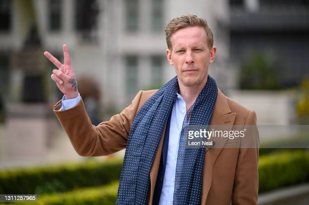 Laurence Fox arrives before launching the manifesto for his bid to become the Mayor of London while standing in front of a statue of former British...