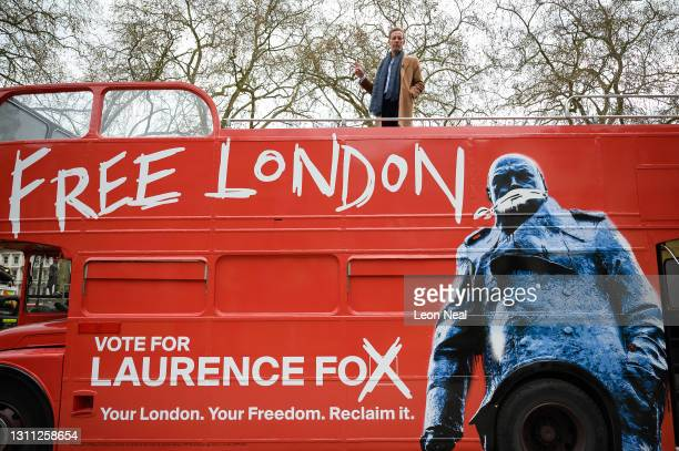 Laurence Fox gestures from the top of his battle bus after launching the manifesto for his bid to become the Mayor of London in Parliament Square on...