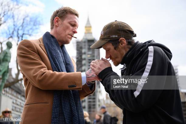 Laurence Fox smokes a cigarette with Rich, a homeless man, who had asked about the homeless crisis as Fox launched the manifesto for his bid to...