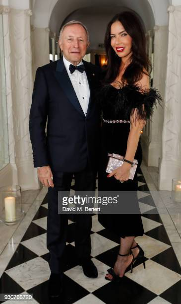 Laurence Graff and guest attend a dinner hosted by Dennis Basso celebrating the inclusion of his portrait by David Downton in The Claridge's Portrait...