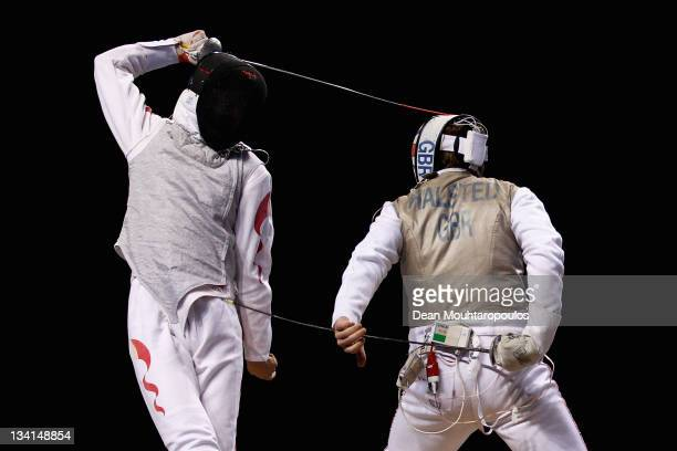 Laurence Halsted of Great Britain in action against Jianfei Ma of China during the Men's Foil Team Event at the Fencing Invitational part of the...