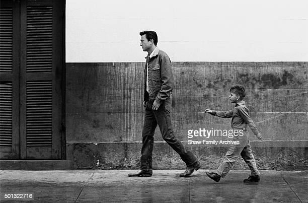 Laurence Harvey with a boy on the street in 1961 during the filming of Walk on the Wild Side in New Orleans Louisiana