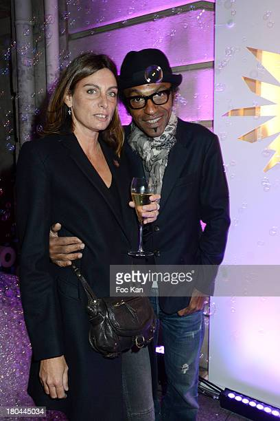 Laurence Katche and Manu Katche attend the Vendanges Montaigne 2013 At Courreges Avenue Montaigne on September 12 2013 in Paris France