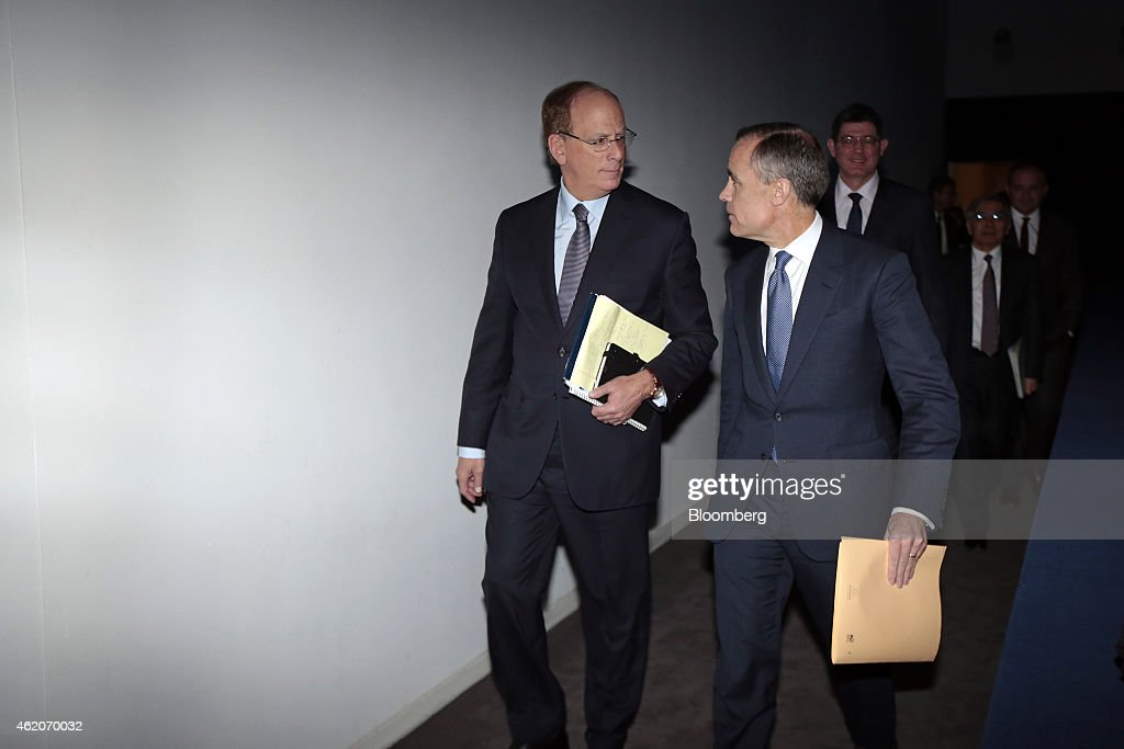Laurence 'Larry' Fink, chief executive of BlackRock Inc., left, talks with Mark Carney, governor of the Bank of England, as they arrive for a session on the final day of the World Economic Forum (WEF) in Davos, Switzerland, on Saturday, Jan. 24, 2015. World leaders, influential executives, bankers and policy makers attend the 45th annual meeting of the World Economic Forum in Davos from Jan. 21-24. Photographer: Jason Alden/Bloomberg via Getty Images Larry Fink; Mark Carney