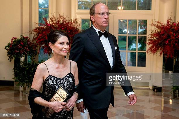 Laurence Larry Fink chief executive officer of BlackRock Inc right and Lori Fink arrive at a state dinner in honor of Chinese President Xi Jinping at...
