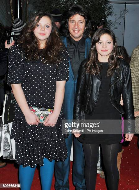 Laurence LlewelynBowen and his daughters Cecile and Hermione arrive at the side door of the Coliseum Theatre in central London for a VIP performance...