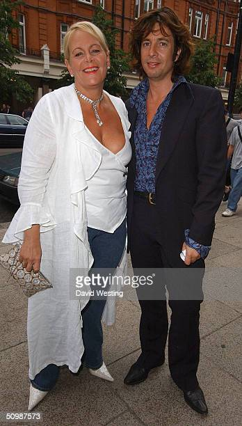 Laurence LlewelynBowen and his wife Jackie attend the Brooke Hospital For Animals party at Monte's June 22 2004 in London England Some of the guests...