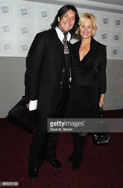 Laurence LlewelynBowen and his wife Jackie LlewelynBowen arrive at the TRIC Awards at the Grosvenor House Hotel on March 10 2009 in London England