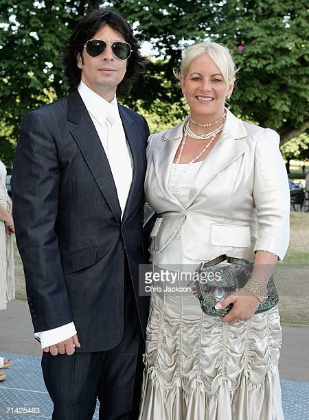 Laurence LlewelynBowen and Jackie LlewelynBowen poses for a picture at the Harper Collins summer party at the Serpentine on July 12 2006 in London...