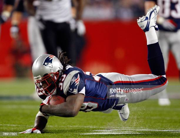 Laurence Maroney of the New England Patriots is tripped against the Jacksonville Jaguars during the AFC Divisional playoff game at Gillette Stadium...
