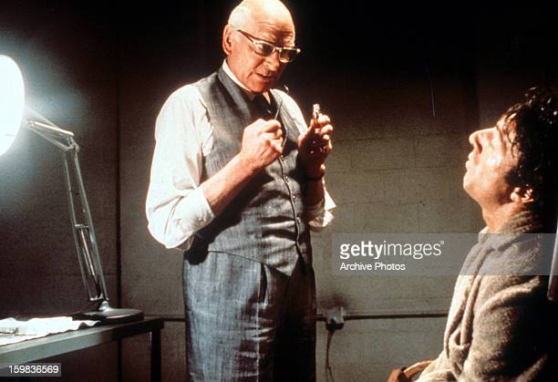 Laurence Olivier about to torture Dustin Hoffman in a scene from the film 'Marathon Man' 1976