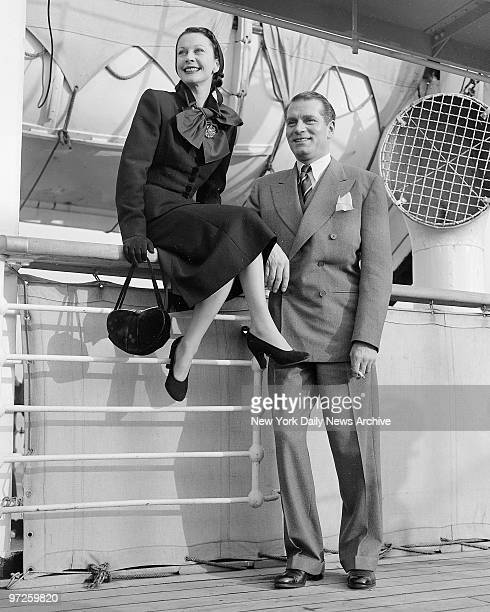 Laurence Olivier and wife Vivien Leigh get view of New York skyline from Mauretania's deck on arrival from England They are to appear in Olivier's...