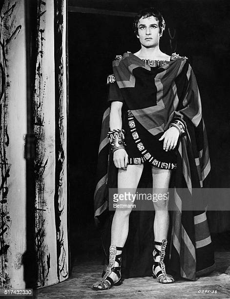 """Laurence Olivier appears as the doomed King Oedipus in a theatrical performance of Sophocles' """"Oedipus Rex."""" Oilvier wears an ancient Greek costume..."""