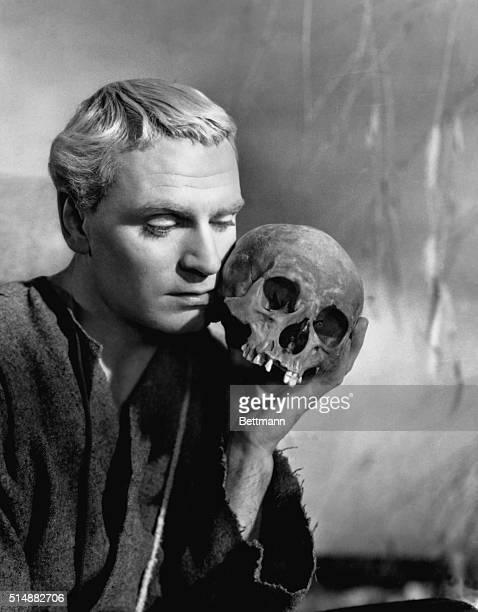Laurence Olivier as Shakespeare's Prince Hamlet of Denmark holds the skull of Yorick in a scene from his film version of 'Hamlet'