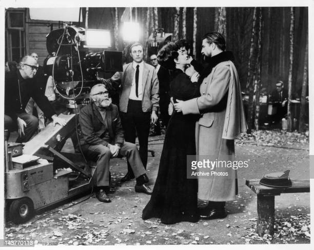 Laurence Olivier directs Joan Plowright and Alan Bates in a scene from the film 'Three Sisters' 1969