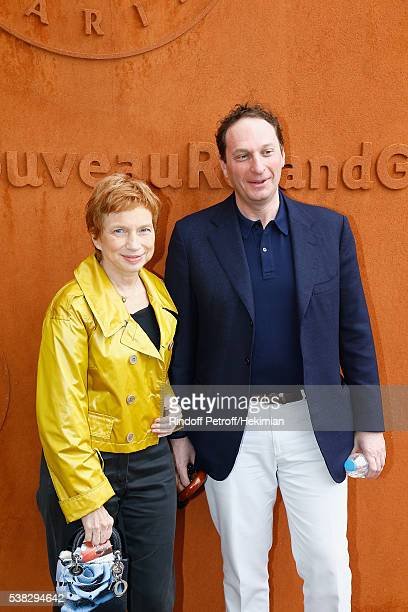 Laurence Parisot and her husband attend the French Tennis Open Day Fifteen with the Final between Novak Djokovic and Andy Murray at Roland Garros on...