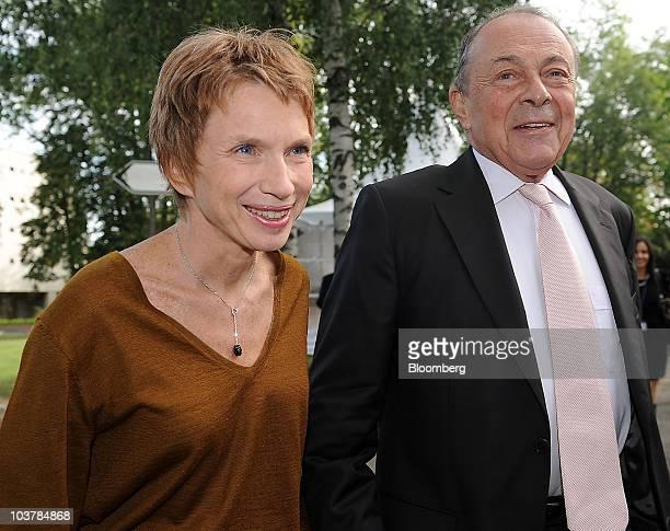 Laurence Parisot president of the Mouvement des Entreprises de France left welcomes Michel Rocard France's former prime minister at the Medef Summer...