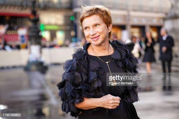 Laurence Parisot wears a necklace a black embroidered flowers short jacket a black dress outside the Opera Garnier 350th Anniversary Gala in Paris on...