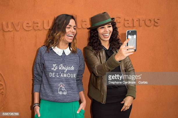 Laurence Roustandjee and Aida Touihri take a selfie during day Fourteen of the 2016 French Open at Roland Garros on June 4 2016 in Paris France