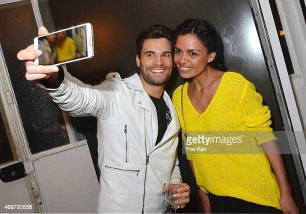 Laurence Roustandjee poses for a selfie with a guest during the Basus Cocktail at Le Perchoir on March 18 2015 in Paris France