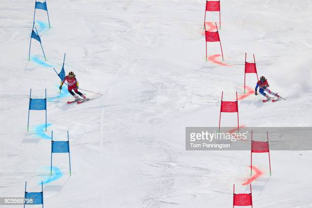 Laurence StGermain of Canada and Adeline Baud Mugnier of France compete during the Alpine Team Event 1/8 Finals on day 15 of the PyeongChang 2018...