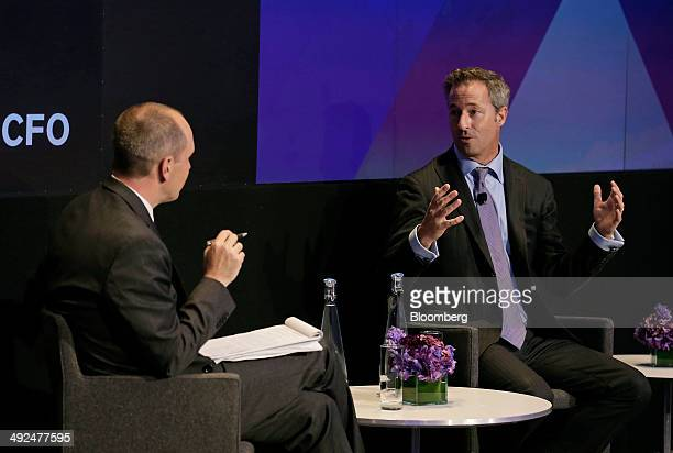 Laurence Tosi chief financial officer of Blackstone Group LP right speaks at the Bloomberg CFO Conference in New York US on Tuesday May 20 2014 The...