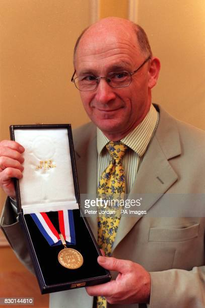Laurence Whitehouse shows his ARP/50 British Gold Hero Award Mr Whitehouse was one of 11 hostages who were used as human shields after being abducted...