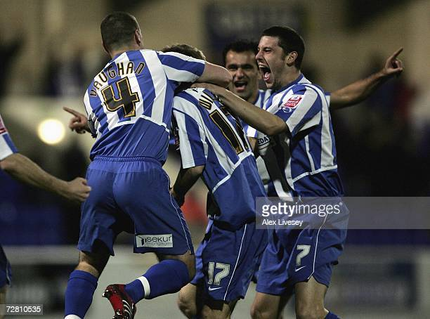Laurence Wilson of Chester City is congratulated by team mates after scoring the opening goal during the FA Cup 2nd round replay match between...