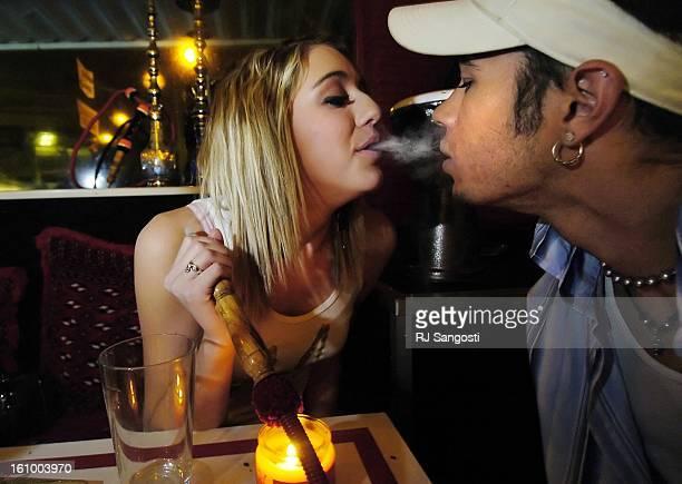 COLO NOV 9 2005 Lauren<CQ> Rhine<CQ> left blows smoke from a Hookah into the mouth of Ian<CQ> Baird<CQ> Wednesday Nov 09 at Marrakesh Cafe Hookah bar...