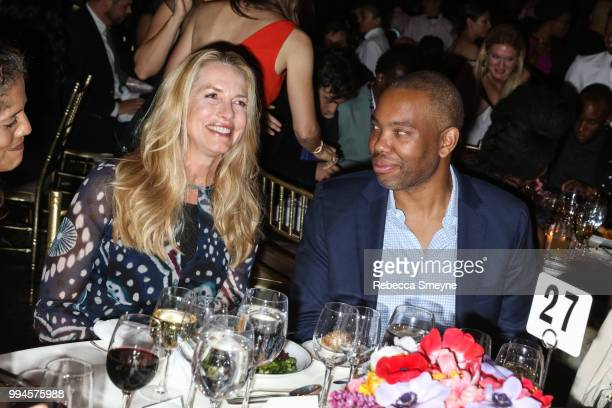 Laurene Powell Jobs and TaNehisi Coates attend the Gordon Parks Foundation Annual Awards Dinner at Cipriani 42nd Street on May 22 2018 in New York...