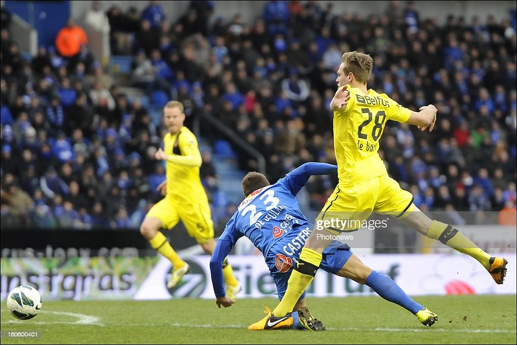 Laurens De Bock of Club Brugge KV makes a penalty fault on Benji De Ceulaer of KRC Genk during the Jupiler League match between KRC Genk and Club Brugge KV on February 3, 2013 in Genk, Belgium.