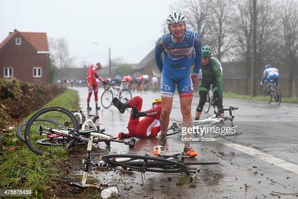 Laurens de Vreese of Wanty-Groupe Gobert Team grimaces in pain after a crash in wet conditions during the Omloop Het Nieuwsblad on March 1, 2014 in...
